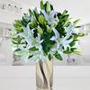 Espuma floral (1.0), Decorado con papel arroz (1.0), Cintarafia (3.0), Ruscus (6.0), Liliums Blancos (10.0)