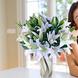 Espuma floral (1.0), Decorado con papel arroz (1.0), Cintarafia (3.0), Ruscus (8.0), Liliums Blancos (20.0)