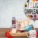 Ciabatta Rustica Migas Aliado Artesanal 190 grs (1.0), AMA Jugo Manzana Arandano Organico 300 cc (1.0), Té Negro Lipton Yellow Label (1.0), Café Gold Instantáneo Stick 1.8 grs Primera Selección (1.0), Galletas  Feliz Cumpleaños 5 und. (1.0), Jalea Gelatina Migas Sabores 180 grs (1.0), PACK RICE BAR MILK (2.0), Taza Happy Birthday (1.0), Globo Feliz Cumpleaños (1.0), CINTASATIN CHAMPAGNE (2.0), Papel celofán (2.0), Papelarroz crema (1.0)